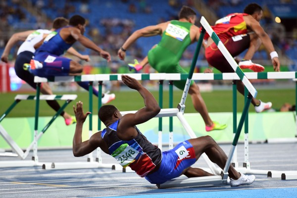 Aug 16, 2016; Rio de Janeiro, Brazil; Jeffery Julmis (HAI) falls during the men's 110m hurdles semifinals in the Rio 2016 Summer Olympic Games at Estadio Olimpico Joao Havelange. Mandatory Credit: Christopher Hanewinckel-USA TODAY Sports